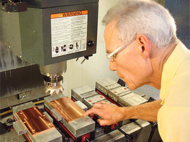 Worker machining copper parts