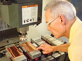 Worker machining copper parts