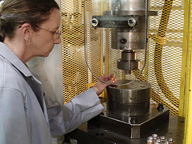 Worker using a specialty cold forming machine